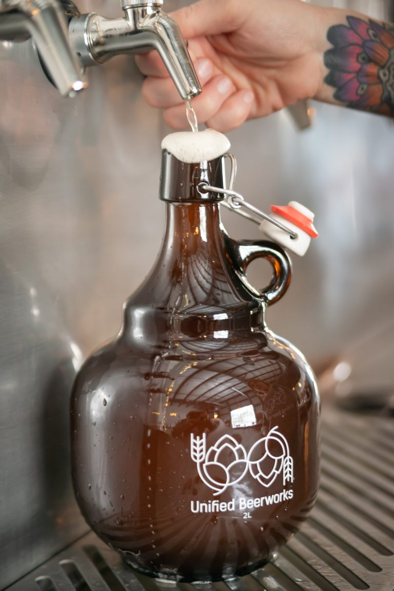Pouring beer into a growler